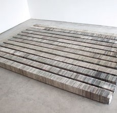 """Kate Hunt (American, born 1956), Floor, Newspaper and steel, 5 1/4"""" x 120"""" x 5 1/4"""" each, installation dimensions variable."""