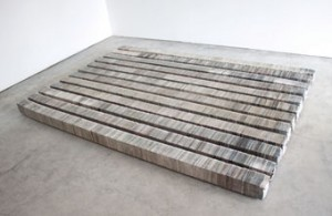 "Kate Hunt (American, born 1956), Floor, Newspaper and steel, 5 1/4"" x 120"" x 5 1/4"" each, installation dimensions variable."