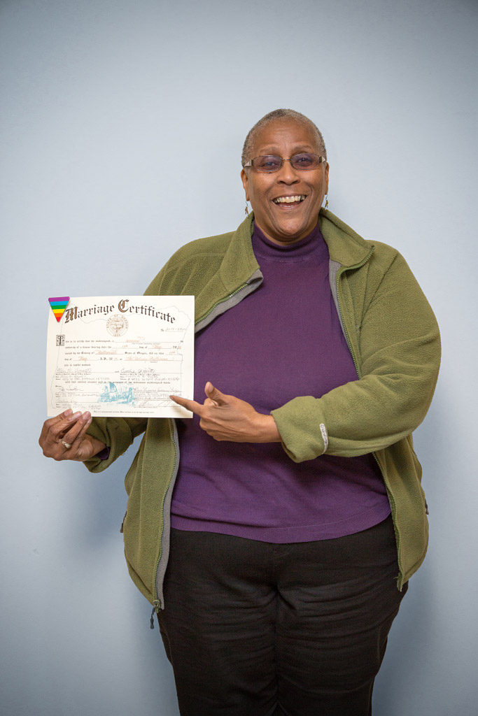Cynthia Butts, 64 proudly displays her commemorative marriage certificate from Oregon. The US Supreme Court legalized marriage for same-sex couples in 2015.