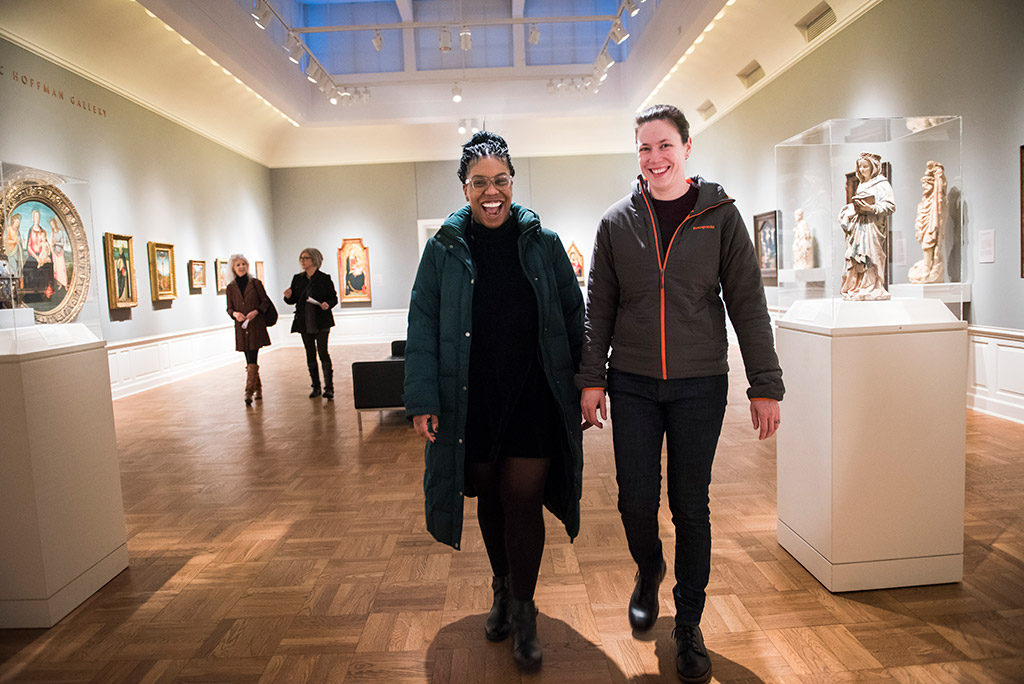 Two women walking through gallery
