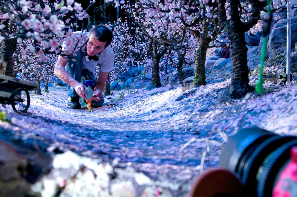 Coraline (Behind The Scenes), Animator Chris Tootell guides Coraline through an orchard of popcorn blossoms. CORALINE ©2009, LAIKA, LLC