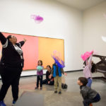 Educator and children interacting in gallery