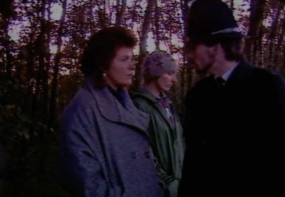 Fence cutting at Greenham Common, film still from Can't Beat It Alone, Part IV, 1985.