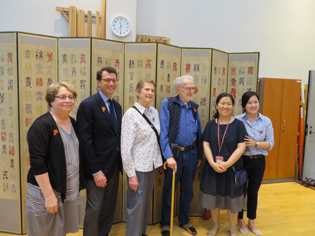 Left to right: Maribeth Graybill, Brian Ferriso, Sandra Mattielli, Robert Mattielli, Conservator Jang Yeon-hee, and Sangah Kim in front of PAM's Subok embroidery screen, in the conservation studio of the National Museum of Korea, Seoul, June 21, 2017.
