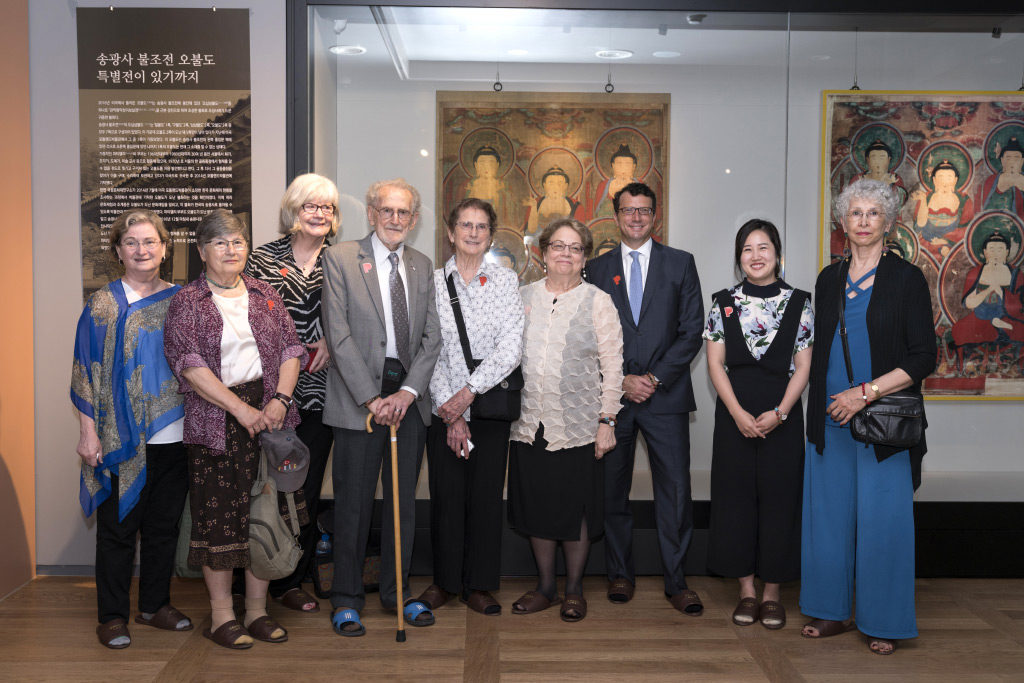 The Portland Art Museum group in front of Five Buddhas installed in the Songgwangsa Monastery Museum. From left: Barbara Trudel, Sylvia Lurie, Jan Quivey, Robert Mattielli, Sandra Mattielli, Maribeth Graybill, Brian Ferriso, Sangah Kim, and Ré Craig. June 23, 2017. Photo courtesy Songgwangsa (photographer Dongyeong Yu).