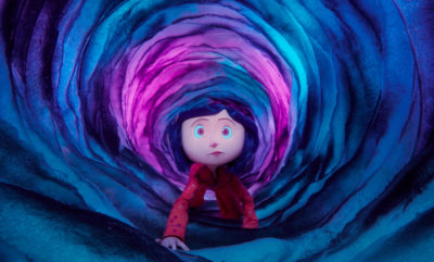 Film still: Coraline discovers the secret tunnel between the Real World and the Other World.