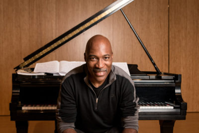 Darrell Grant sitting at piano