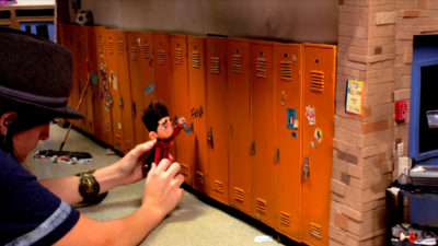 ParaNorman (Behind The Scenes) – Animator Rachel Larsen coaxes an emotional scene out of a Norman puppet. PARANORMAN ©2012, LAIKA, LLC