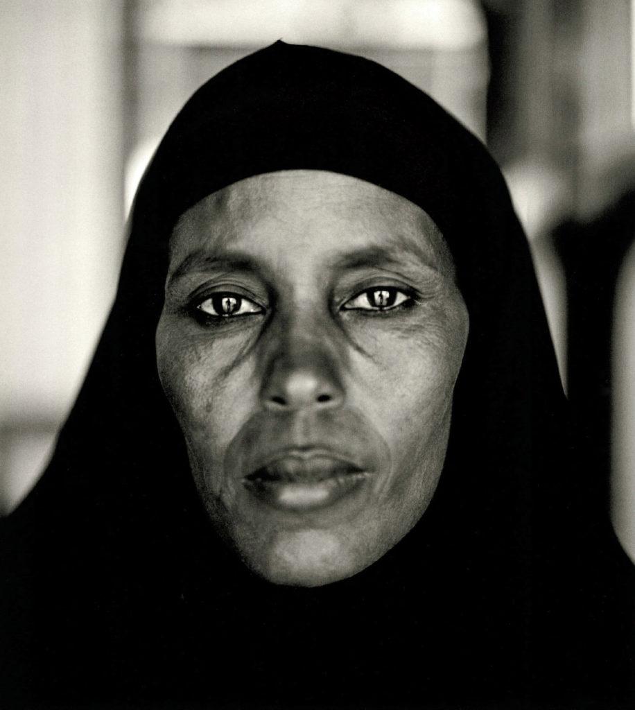 Fazal Sheikh, Abshiro Aden Mohammed, Women's Leader, Somali Refugee Camp, Dagahaley, Kenya, 2000, from the series A Camel for the Son. © Fazal Sheikh.