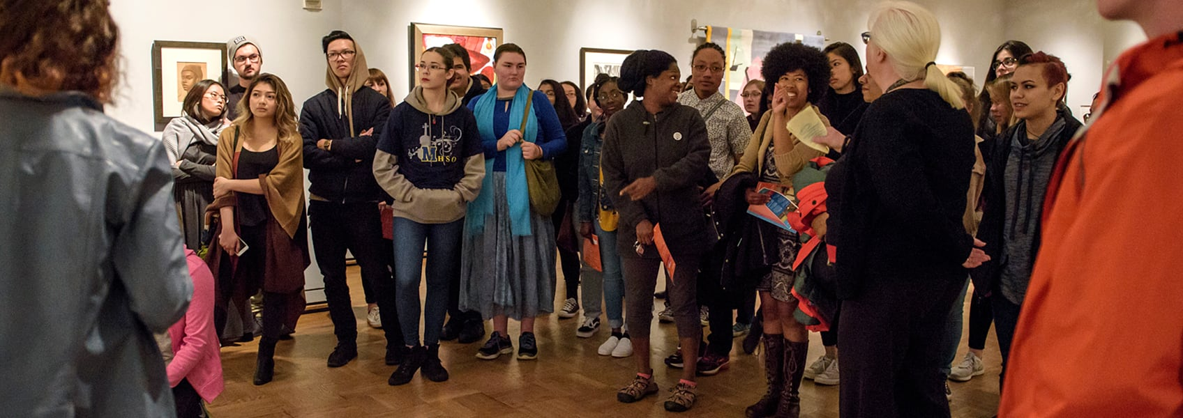 A group of visitors on a tour in one of the museum's galleries.