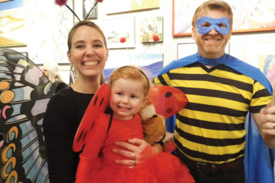 Family dressed in Halloween costumes.