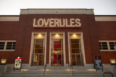 Loverules installation on front of museum entrance