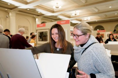 Attendees viewing prints at the Print Fair.